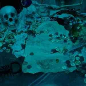 "A close up of the treasure. The map is a ""Goonies"" replica treasure map."