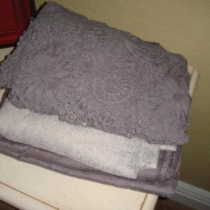 Thrift store finds. Old table cloths dyed different shades of Grey.