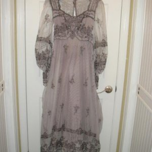 Vintage wedding dress that I dyed gun metal grey. For 20 bucks. Going to be my costume this year. Glamour Ghoul