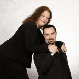 My fiance & I. This is one of our engagement photos. Check out what's in my right hand!
