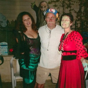 Halloween 2003. L-R: Cancan girl, the beat-up Cubs fan from I think the 2003 World Series (?), and Voodoo priestess.