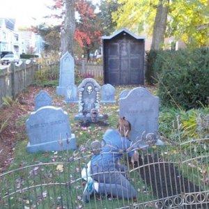 30. Mausoleum assembled as much as is completed in background of Halloween display.