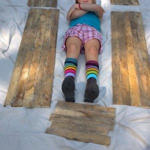 8. Side panels all glued up. My daughter is demonstrating their relative placement on the coffin.