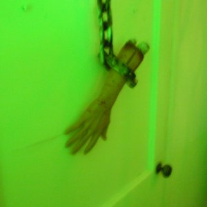 Hand hanging on our furnace room door.  There are holes at the bottom for ventilation and we put a strobe light inside...looked like a torture chamber