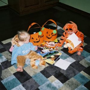 Tiger and Roo (my twin daughters) admiring all their new Halloween books.