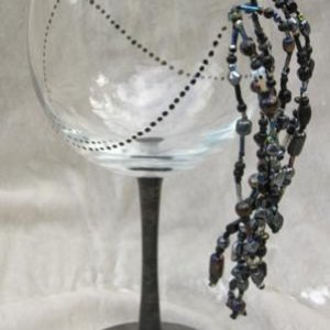 "More of my handmade stuff. I call it the ""Bustle Goblet"". 8 strands of iridescent black glass beads, anchored to the glass with Swarovsski c"