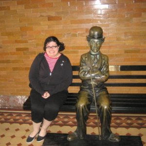 With a Charlie Chaplin statue at the Bradbury building in LA