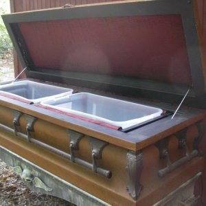 beverage cooler made from old coffin. Has led up lighting thru the ice when full .