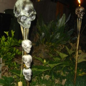 Tiki torches at night