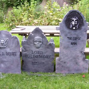 closeup of some of the tombstones my husband & I made!  the neighborhood kids loved the Lord Voldemort tombstone and would come by frequently duri