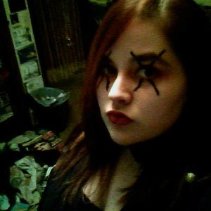 "just a head shot, but I dressed as ""the ultimate MCR fan"". wore a t-shirt variant of a punk leather jacket. arm had a bat drawn on it and &q"