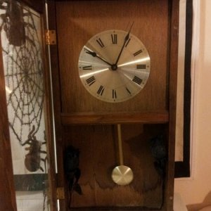 open big clock...just wood laying around and a walmart cheapie clock..used a music box and a doorbell ringer converted for two chimes