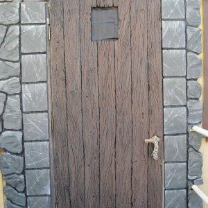 "2008 Entry door, to the 2008 haunt.  About 7'-6"" tall.  Door and stones all made of foam carved with hot knife tools."