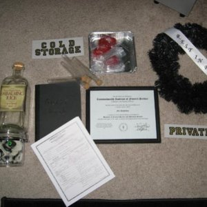 Some morgue props..includes the Mortician's diploma, and death certificate, guest book, embalming fluid jar, etc.