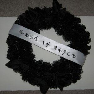 Funeral wreath...hard to see, has black roses
