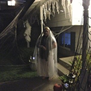 Mom looking ghostly in front of the house.
