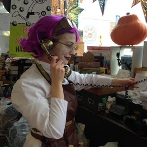 Hello, you've reached your friendly local literature and mad science supply warehouse, how may I help you?  Working at the bookshop on Halloween.