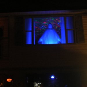 The ghost in the window. Kaleidoscope light in background.