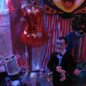 Ventriloquist and circus babe-her dress lights up