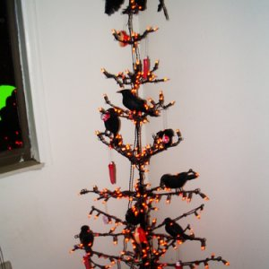 Found this tree at a garage sale for $4 and didn't know what to do with it. Why not have a flock of homicidal crows? lol