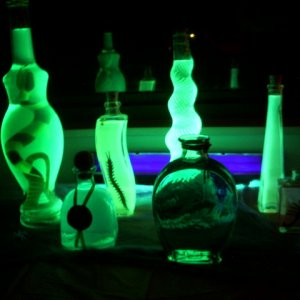 ...and here are the potions under black light. For some reason the orange glowed green :(