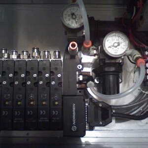 solenoid control box: left = 6 solenoid bank, middle  regulators one redundant, barrier strip for power splitting and ground ties, right = din rail wi