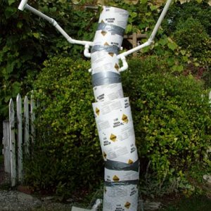 3.  Tubes were cut and taped to provide some shape to the tree trunk.  PVC branches (arms) are in place.
