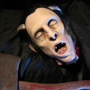 Not a mask, but this is the #4 offering from the Monster of the Month Club. Severed Vampire head sculpted by Jordu Schell.