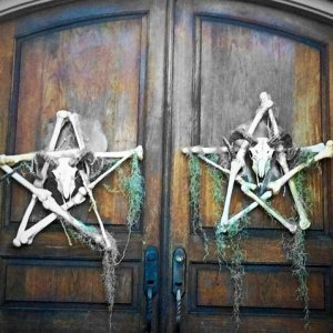 Front Doors showing Pentagram Bone Wreaths