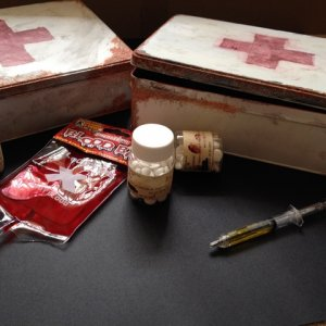 Survival kit prizes for the quiz winners. The containers are biscuit tins that I painted, the contents pictured are syringe pens, 'blood bag' candy an