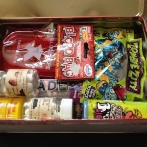 More prizes; zombie cookie cutters, 'brain licker' candy, zombie figurine and glowing slime.