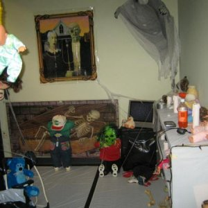 2301 Doll room  -  With flash.  Yes the blue bear did swing throughout the haunt.  Battery operated swing.   (ignore the Orange soda and randoms. (tap