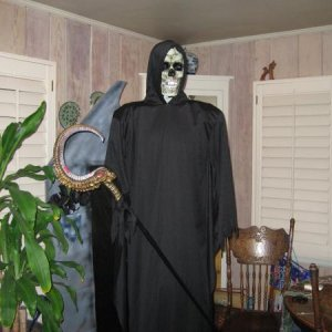 "Grimm Reaper I made out of a T bar stand base, costume, pilllows, and packing foam. The prop stick I picked up at the "" 99 Cents Only Store"""