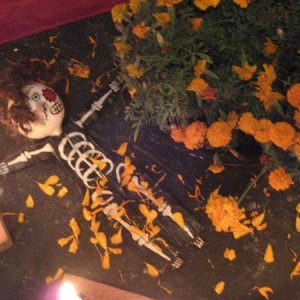 skeleton laying at the bottom of an altar
