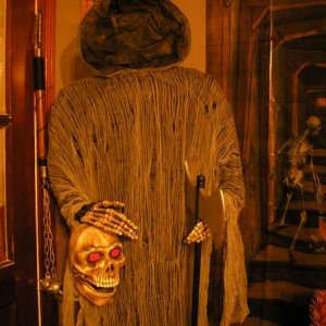 "Headless greeter. He rocks back and forth with a ""Happy Halloween"" greeting."