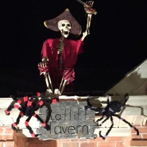 Pirate above front door greeting spooks!