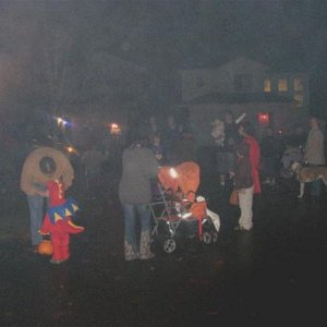 Visitors gather to watch the show as the fog from the cannons envelopes the neighborhood.