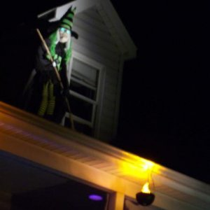 A witch on the roof with a deadly stare (green LED).