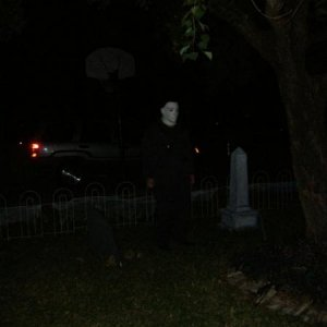 My dear hubby as Michael Myers. He stood out in our graveyard for HOURS, stock still, waiting to scare passing TOTs. (not little ones ;) )