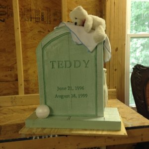 Playing around with the location of the baby blanket, ball and bear. also decided to simplify the epitaph with just the word Teddy and dates