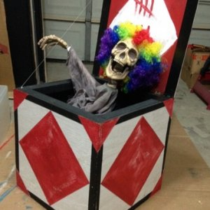 Jack in the box: shiatsu hacked grave grabber with a $1 store clown wig for our creepy carnival Halloween display!