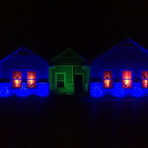 Halloween 2015   This photo captures the actual look of the house up lighting. Was taken with a better camera.