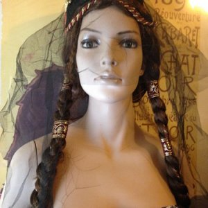 Our new mannequin, Persephone. She's an classic model with real glass eyes, colored an interesting shade of green, and comes complete with some aged c