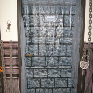 This was the door into a family crypt.  The Moore (Anita Moore-Tishan's family crypt).  Set of keys hanging by the door and the chains and locks.  Was