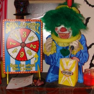 Evil mini clown with wheel of misfortune where you spin it to pick how you're going to be tortured by the clown.