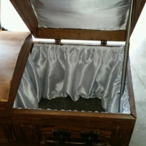 New life to the old casket. My #3 daughter sewn in a pearl lining in time for Norman's wake.