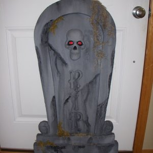 The tombstones started life off-the-shelf from Spirit Halloween, then I made foam castings of them and painted them up.