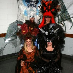girls halloween2007, they were different themed queens the one in white Ice queen, the one in orange and black halloween queen, the one in brown harve
