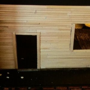 All of the siding was done with coffee stirrers.  I started out using Popsicle sticks but found they were hard to cut.
