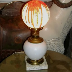 Better pic of the bloody lamp. Base is antique - marble base and brass (from FreeCycle). The top globe is a plastic replacement that I spraypainted. I